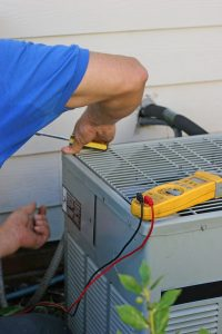 technician working on air conditioner