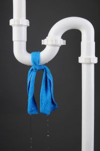 white pipe with blue cloth tied around it