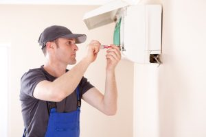 technician-installing-ductless-air-handler