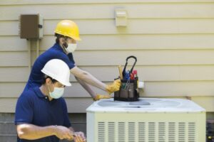 outside-unit-of-air-conditioner-with-techs-working