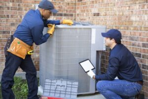 two-techs working-on-ac